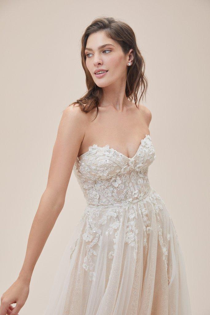Wedding Dresses - Bride in Wedding Dress On Pink Background