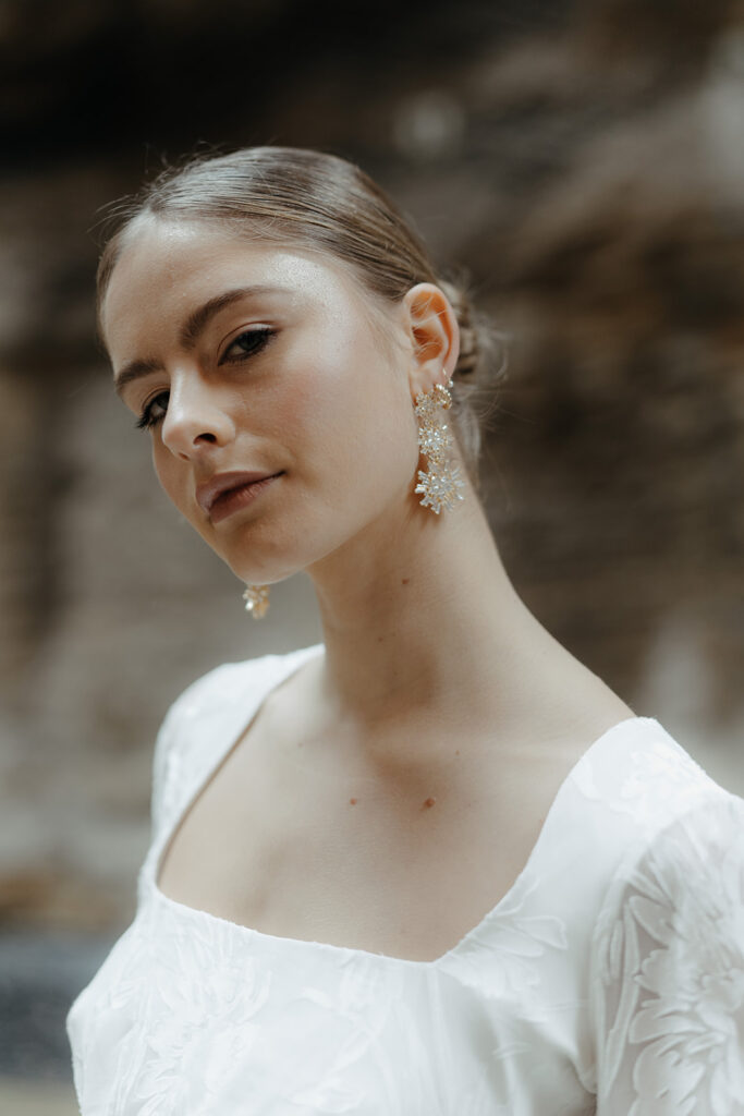 Wedding Accessories - Bride in White With Gold Earrings